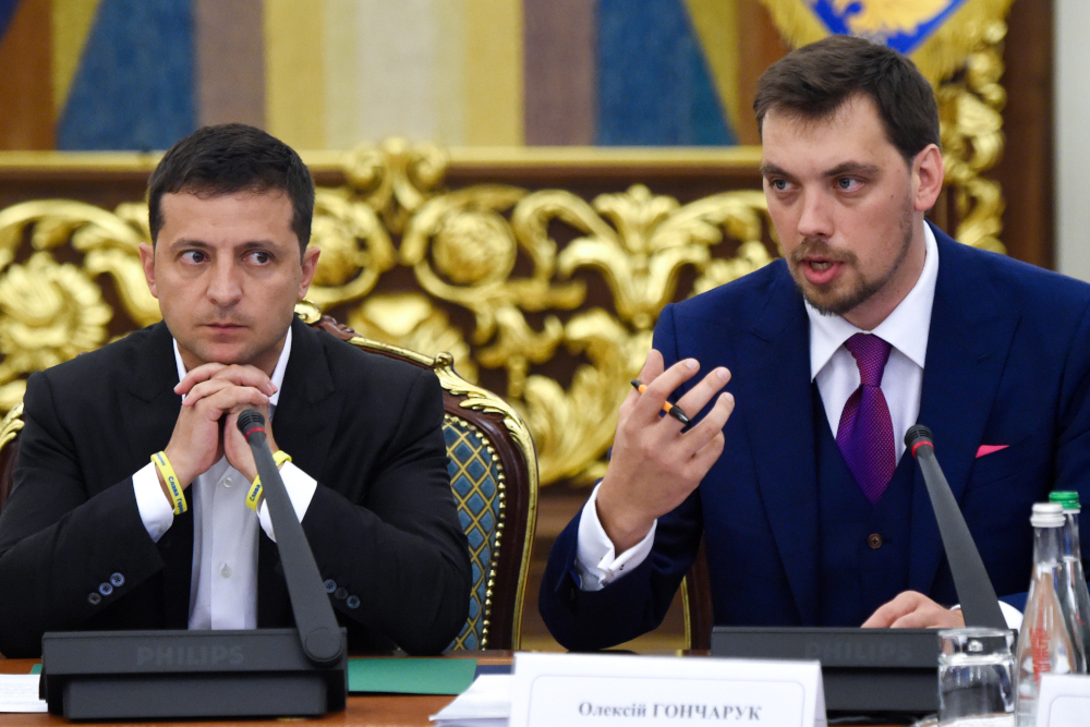 In this file photo taken September 02, 2019 Ukrainian President Volodymyr Zelensky (left) listens as Prime Minister Oleksiy Goncharuk speaks during a meeting with the new members of the government and new president of Parliament, in Kiev. — AFP pic