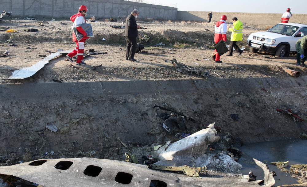 Rescue teams recover debris from a field after a Ukrainian plane carrying 176 passengers crashed near Imam Khomeini airport in the Iranian capital Tehran January 8, 2020, killing everyone on board. — AFP pic