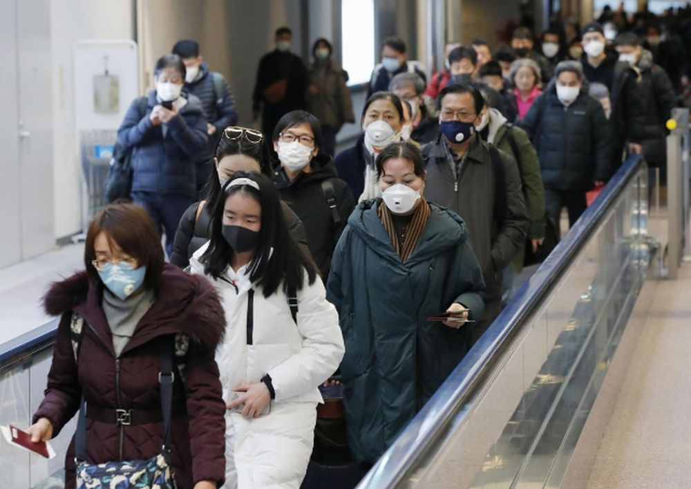 Passengers arriving from the Chinese city of Wuhan arrive at Narita Airport in Chiba, Japan in this photo taken by Kyodo January 23, 2020. — Kyodo pic via Reuters
