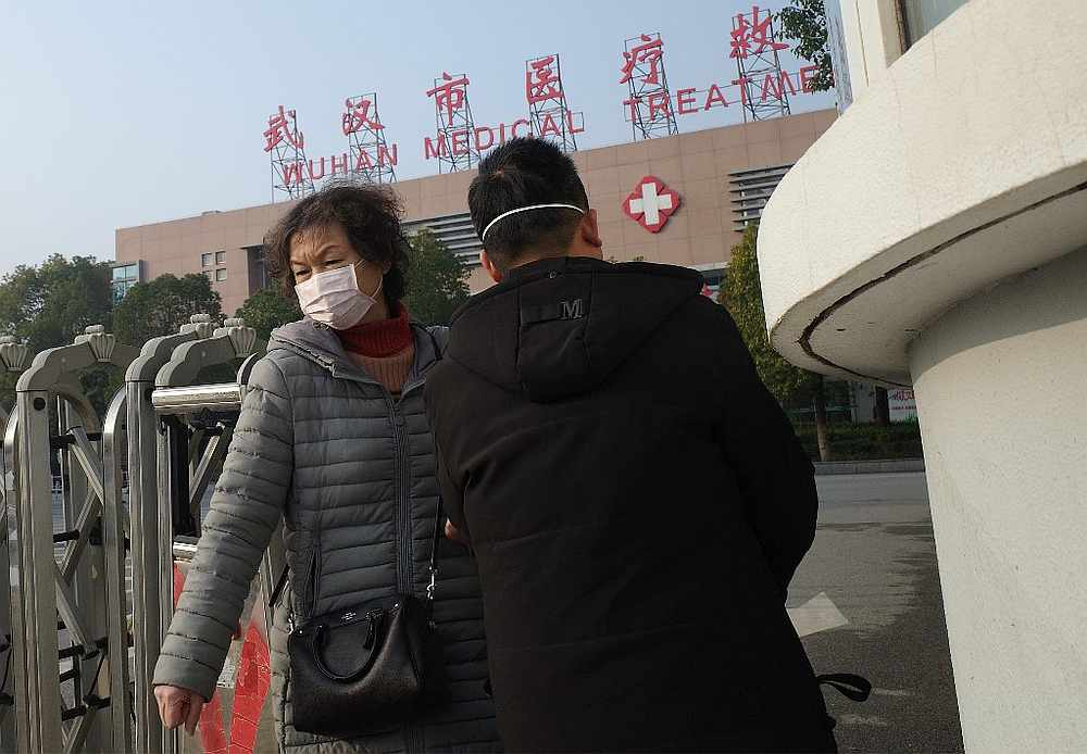 A woman leaves the Wuhan Medical Treatment Centre, where a man who died from a respiratory illness was confined, in the city of Wuhan, Hubei province January 12, 2020. — AFP pic