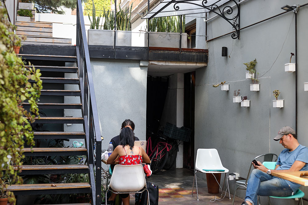 The sunny open-air courtyard at Full City Coffee House.