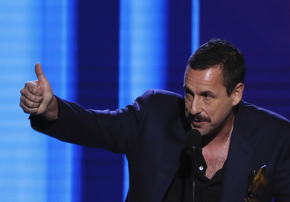 Adam Sandler accepts the Best Male Lead award for 'Uncut Gems' at the 35th Film Independent Spirit Awards in Santa Monica February 8, 2020. — Reuters pic