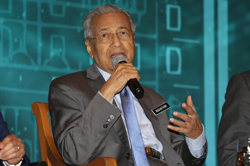 Tun Dr Mahathir Mohamad answers questions at the dialogue session with the French business community in Cyberview Lodge Resort, Cyberjaya February 10, 2020. — Picture by Choo Choy May