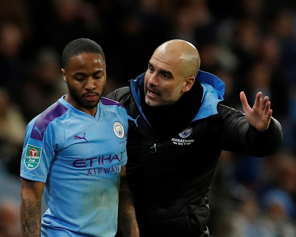 Manchester City manager Pep Guardiola with Raheem Sterling during the Carabao Cup semi-final second leg match with Manchester United at Etihad Stadium in Manchester January 29, 2020. — Reuters pic