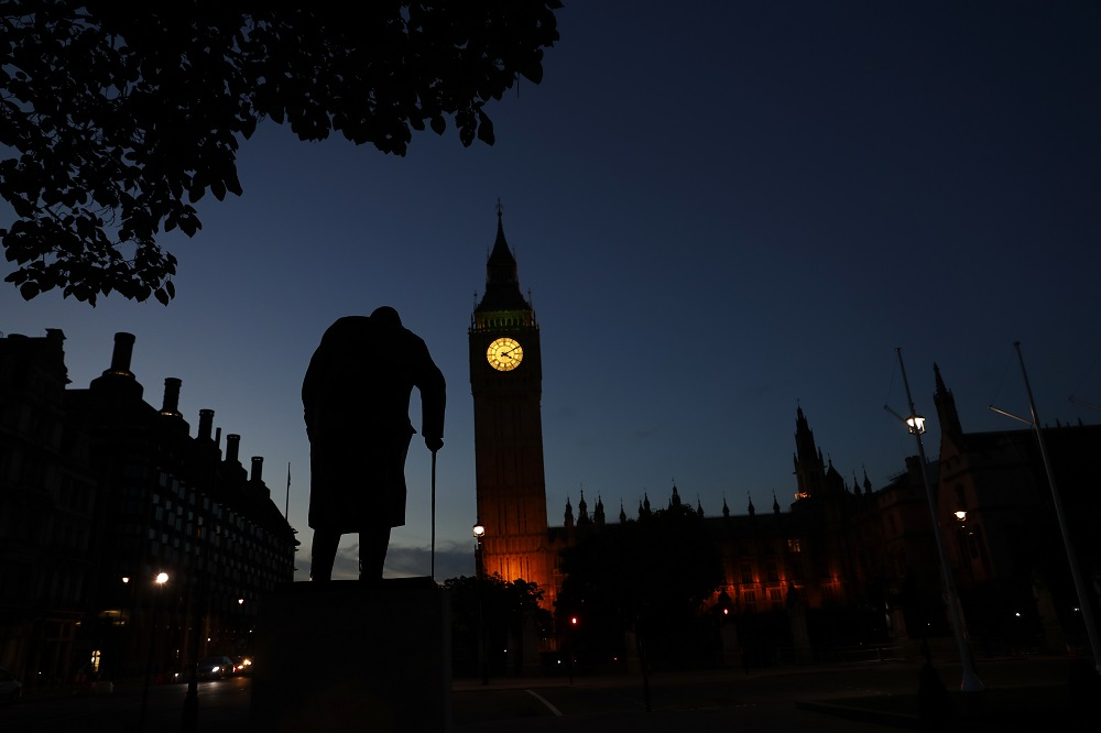 Dawn breaks behind the Houses of Parliament and the statue of Winston Churchill in Westminster, London June 24, 2016. — Reuters pic