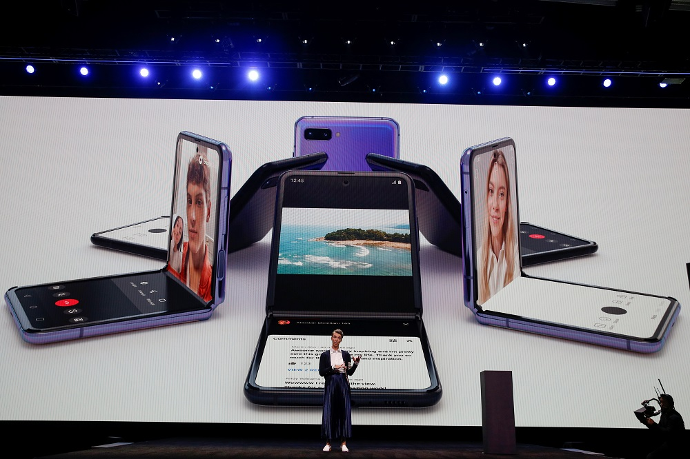 Rebecca Hirst, head of UK product marketing of Samsung Electronics, unveils the Z Flip foldable smartphone during Samsung Galaxy Unpacked 2020 in San Francisco February 11, 2020. — Reuters pic