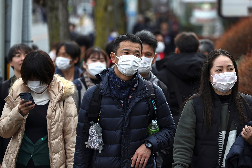 People wearing protective face masks are seen before a rehearsal of the Tokyo 2020 Olympic Torch Relay in Hamura, outskirts of Tokyo February 15, 2020. — Reuters pic