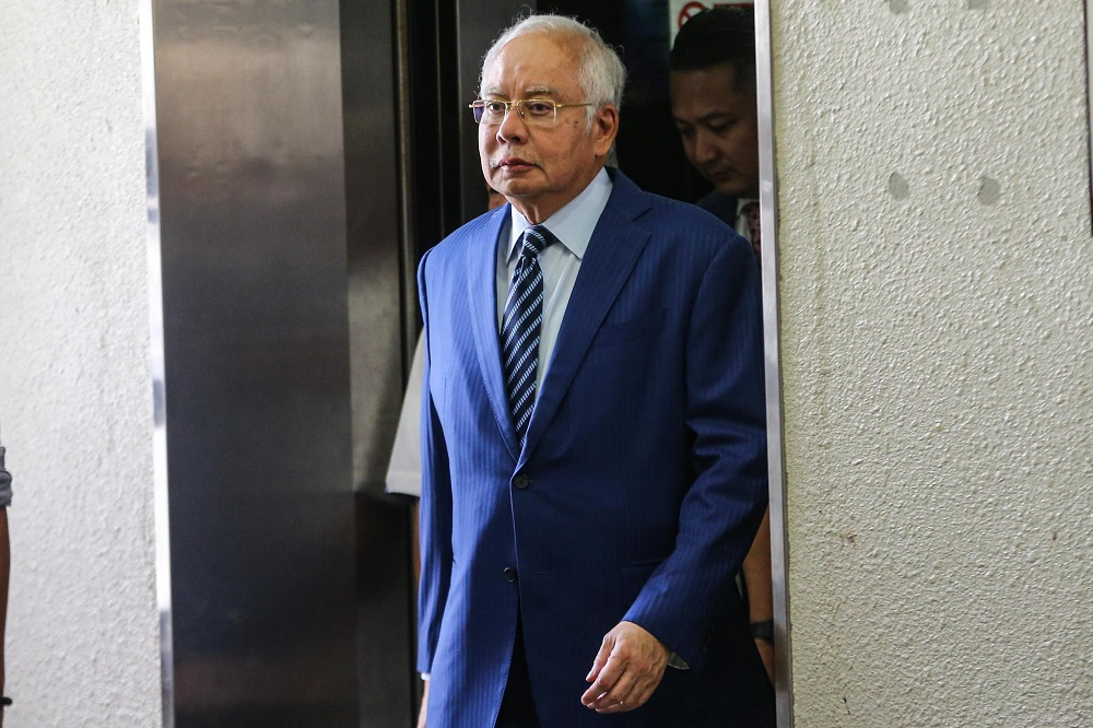 Former prime minister Datuk Seri Najib Razak is facing four charges of using his position to obtain bribes totalling RM2.3 billion from 1MDB funds and 21 charges of money laundering involving the same amount. — Picture by Hari Anggara