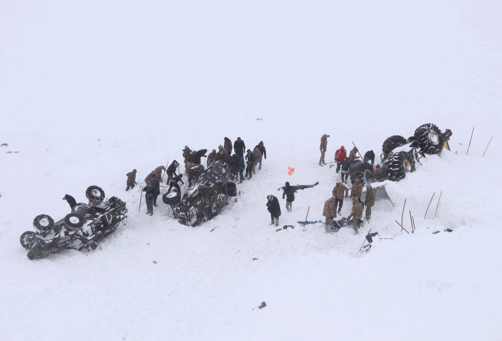 Turkish soldiers and locals try to rescue people trapped under an avalanche in Bahcesaray in Van province, Turkey, February 5, 2020. — Reuters pic