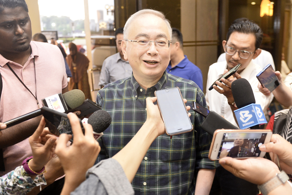 Datuk Seri Wee Ka Siong said the biggest challenge during MCO for the logistics sector is how to ensure goods reach their destination smoothly. — Picture by Miera Zulyana