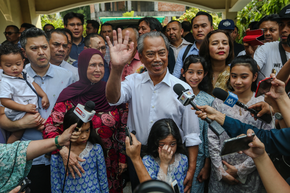 Parti Pribumi Bersatu Malaysia president Tan Sri Muhyiddin Yassin celebrates after being appointed as Malaysia's 8th Prime Minister in front of his house in Bukit Damansara February 29, 2020. — Picture by Firdaus Latif