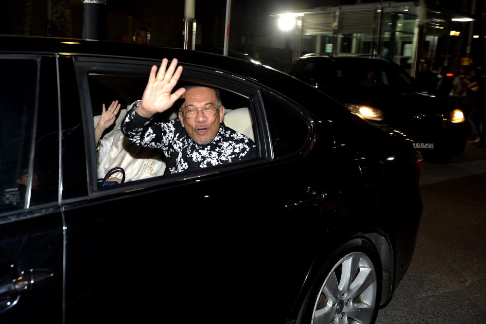 Datuk Seri Anwar Ibrahim leaves Yayasan Al-Bukhary February 29, 2020. — Picture by Miera Zulyana