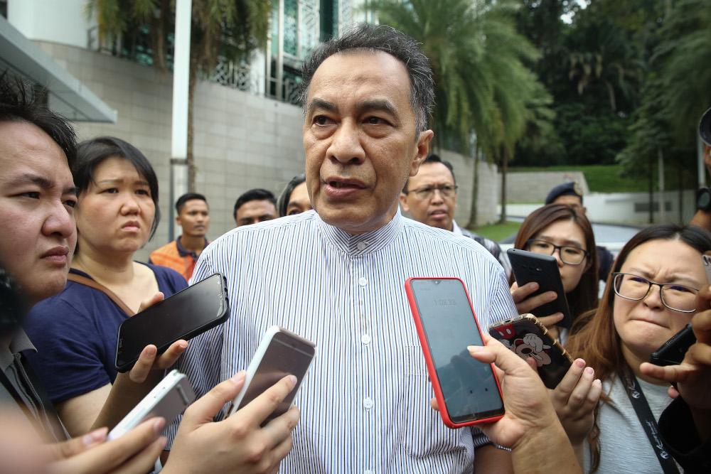 Datuk Husam Musa speaks to reporters outside the Yayasan Al-Bukhary in Kuala Lumpur February 29, 2020. — Picture by Yusof Mat Isa