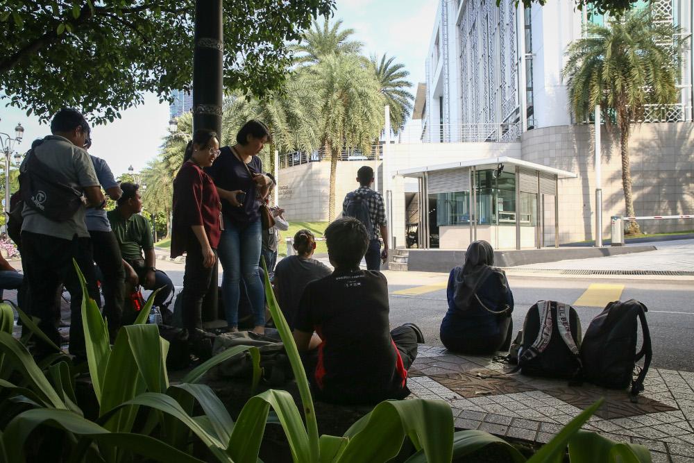 Members of the media wait outside the Yayasan Al-Bukhary in Kuala Lumpur February 29, 2020. — Picture by Yusof Mat Isa