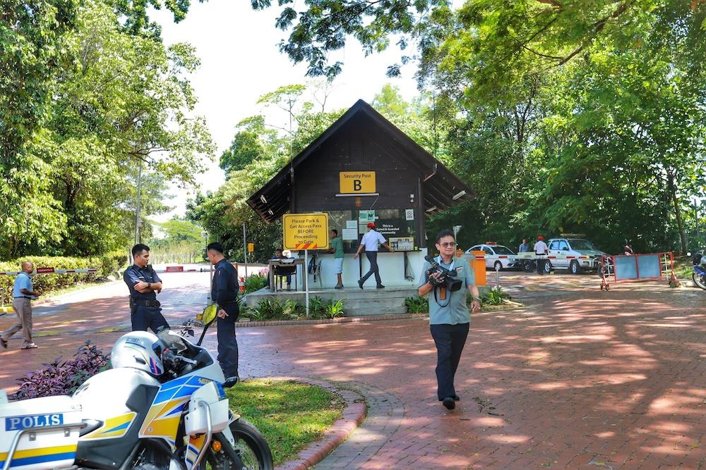 Members of media gather outside Gate B of Tun Mahathir's housing area in Seri Kembangan February 24, 2020. — Picture by Ahmad Zamzahuri
