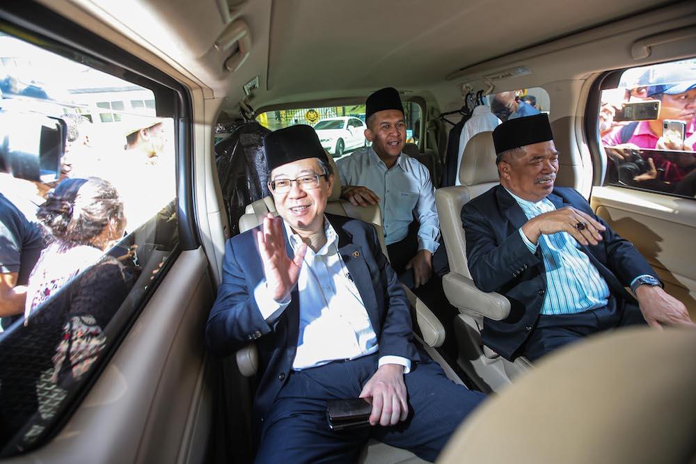DAP secretary-general Lim Guan Eng and Parti Amanah Negara president Mohamad Sabu are seen leaving Istana Negara, February 29, 2020. — Picture by Hari Anggara