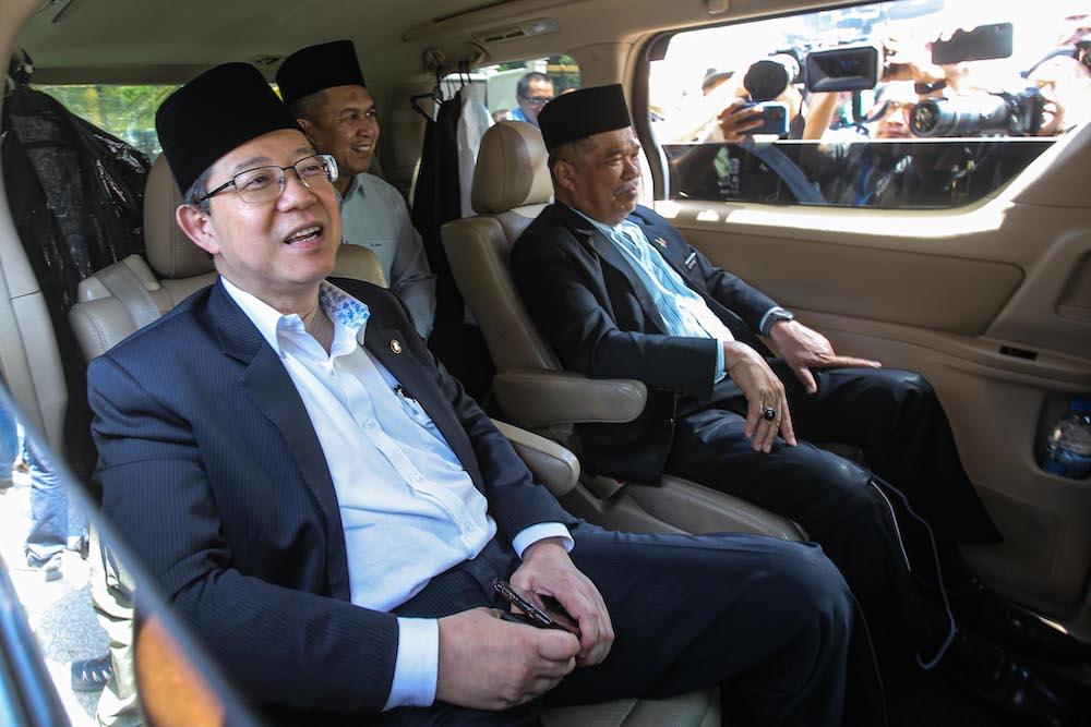 DAP secretary-general Lim Guan Eng and Parti Amanah Negara president Mohamad Sabu are seen leaving Istana Negara February 29, 2020. — Picture by Hari Anggara