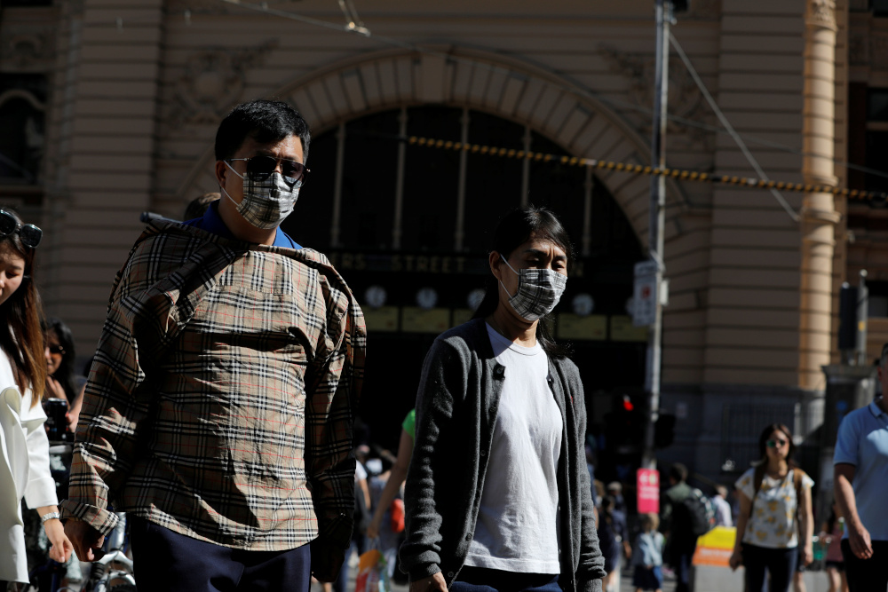 People wearing face masks walk by Flinders Street Station after cases of the coronavirus were confirmed in Melbourne, Victoria, Australia, January 29, 2020. — Reuters pic