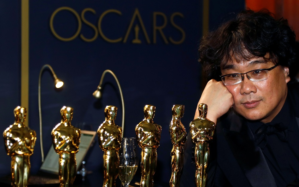 Bong Joon-ho poses with the Oscars for 'Parasite' at the Governors Ball following the 92nd Academy Awards in Los Angeles, California February 9, 2020. — Reuters pic