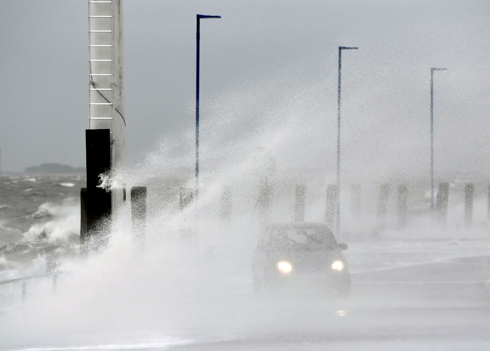 A car is seen in the harbour as storm 'Sabine' hits coast of Dagebuell at the North Sea, Germany, February 9, 2020. — Reuters pic