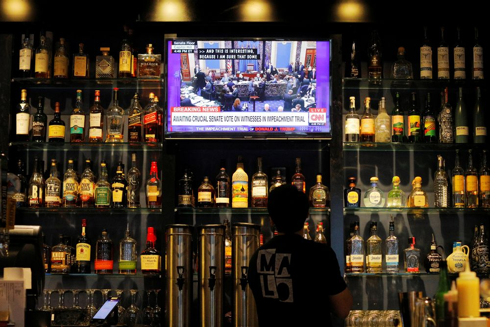 The US Senate impeachment trial of President Donald Trump plays on a television at Malo restaurant in Des Moines, Iowa, US, January 31, 2020. — Reuters pic