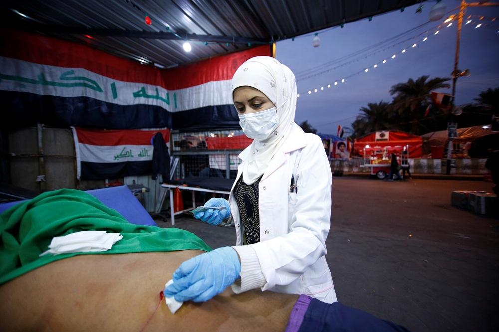 Hannaa Jassem, 24, an Iraqi nurse helps a wounded man in Baghdad, Iraq January 12, 2020. — Reuters pic