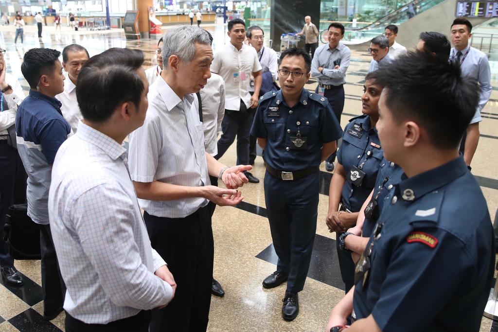 Singapore Prime Minister Lee Hsien Loong interacts with Cisco officers at Changi Airport Terminal 3 February 14, 2020. — TODAY pic
