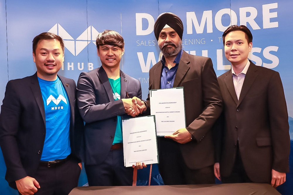 (From left) MHub co-founder and chief experience officer Jason Ding, MHub co-founder and CEO Quek Wee Siong, NewParadigm Capital Markets managing director Charanjeev Singh and NewParadigm Capital Markets executive director Danny Kwan.