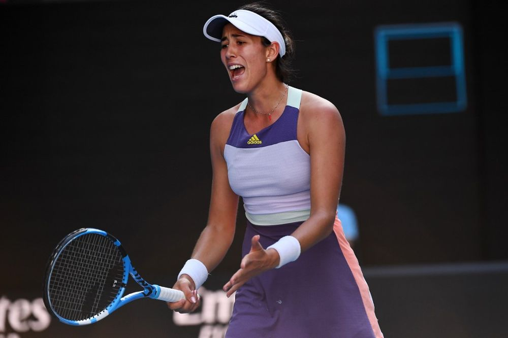 Spain's Garbine Muguruza reacts as she plays against Romania's Simona Halep during their women's singles semi-final match on day eleven of the Australian Open tennis tournament in Melbourne on January 30, 2020. — AFP pic