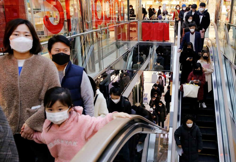 People wearing masks to prevent contracting the coronavirus take the elevator to buy masks at a department store in Seoul, South Korea February 27, 2020. — Reuters pic