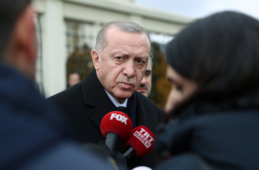 Turkish President Tayyip Erdogan talks to journalists in front of a mosque as he leaves friday prayers in Istanbul, Turkey, February 21, 2020. — Murat Cetinmuhurdar/Presidential Press Office handout pic via Reuters