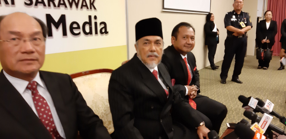 Sarawak Speaker Datuk Amar Asfia Awang Nasar (centre) speaks to reporters on the Federal Court's decision to disqualify Dr Ting Tiong Choon to represent the Pujut state constituency February 11, 2020. — Picture by Sulok Tawie