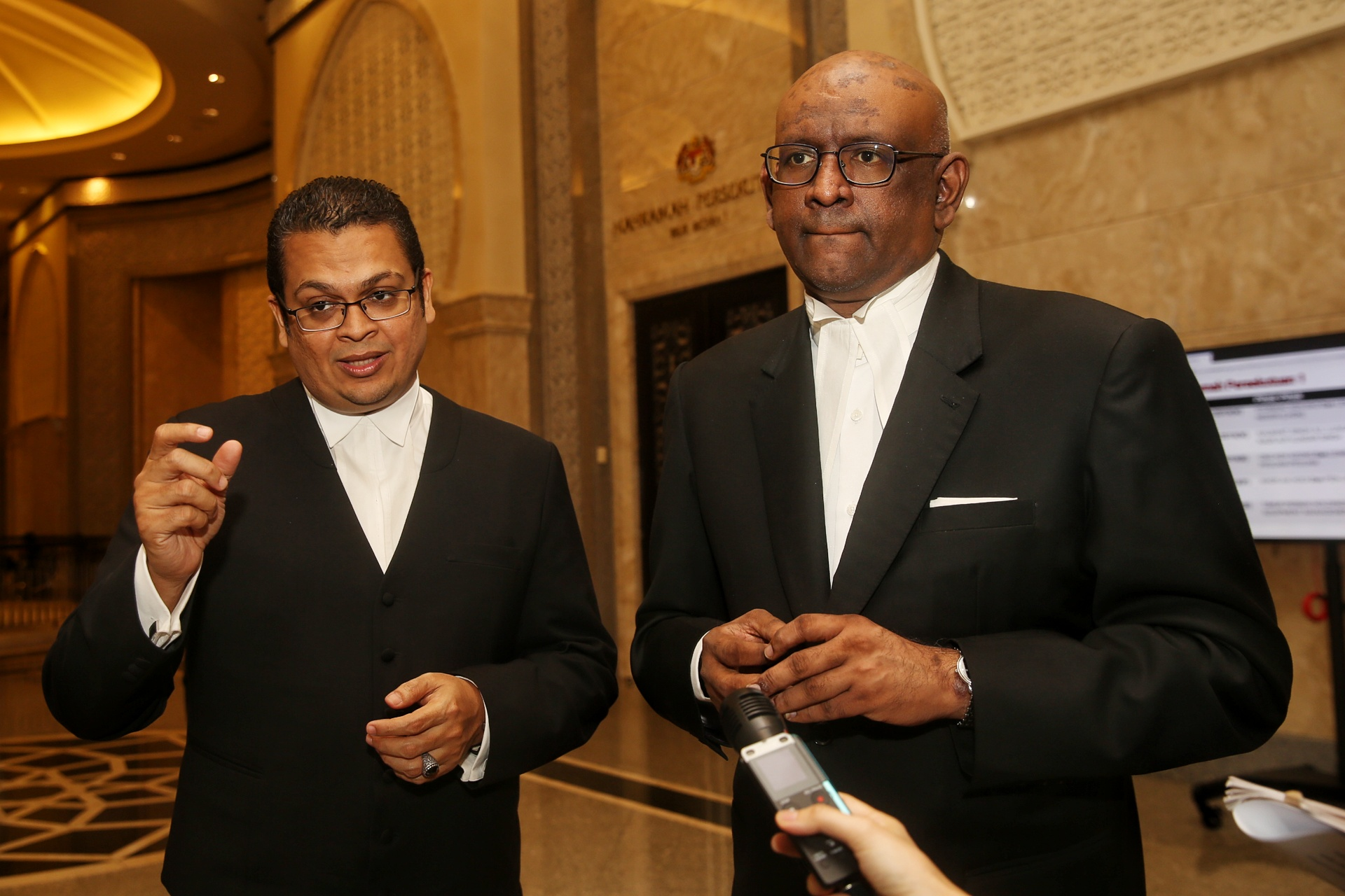 Lawyers Nizam Bashir (left) and K. Shanmuga speak to reporters at the Federal Court in Putrajaya February 13, 2020. ― Picture by Choo Choy May