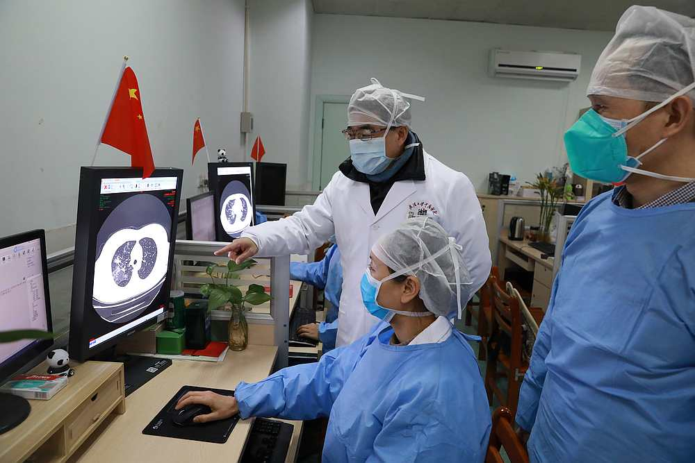 Medical workers inspect the CT (computed tomography) scan image of a patient at the Zhongnan Hospital of Wuhan University, Hubei province, China February 2, 2020. — China Daily pic via Reuters