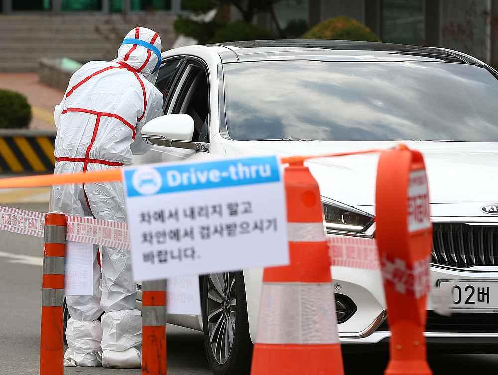 A driver gets a coronavirus test at a drive-through clinic at a hospital in Daegu, South Korea February 27, 2020. — Yonhap pic via Reuters