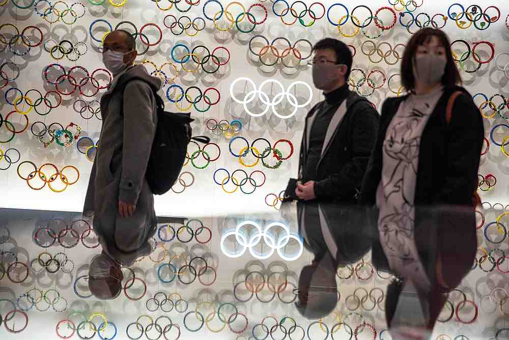 People wearing protective face masks are seen at The Japan Olympics museum in Tokyo, Japan February 26, 2020. — Reuters pic
