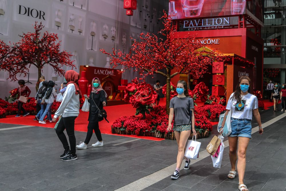 People wearing face masks are pictured outside Pavilion Kuala Lumpur February 10, 2020. — Picture by Firdaus Latif