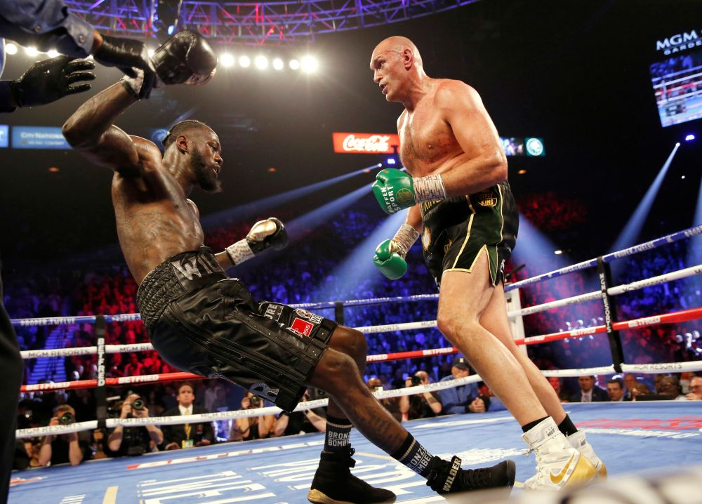 Tyson Fury knocks down Deontay Wilder during the fight in Las Vegas February 22, 2020. — Reuters pic