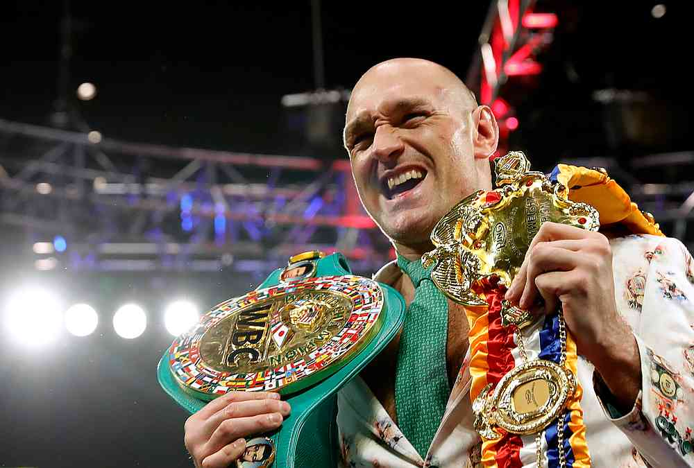 Tyson Fury poses with his belts during a press conference after the  WBC heavyweight title fight at Grand Garden Arena, Las Vegas February 22, 2020. — Reuters pic