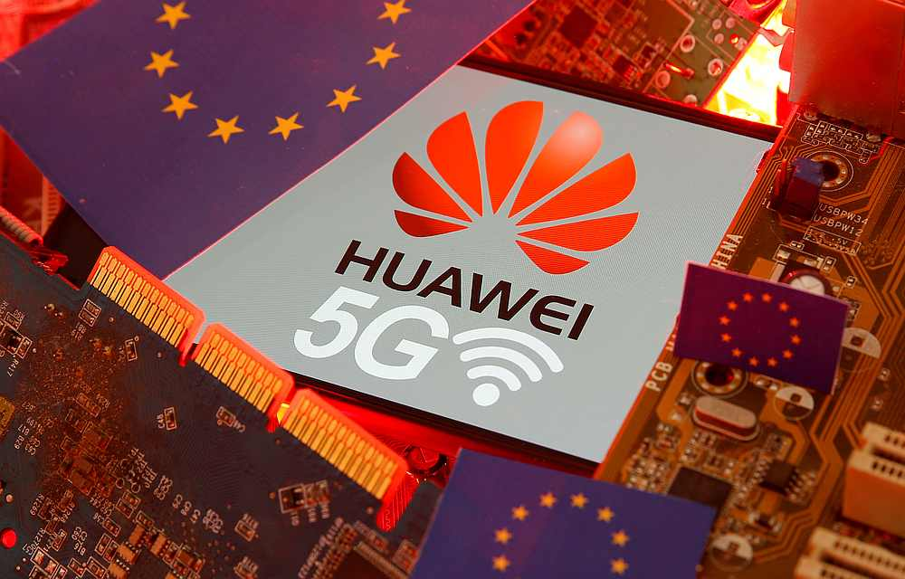 The EU flag and a smartphone with the Huawei and 5G network logo seen on a PC motherboard in this illustration January 29, 2020. — Reuters pic