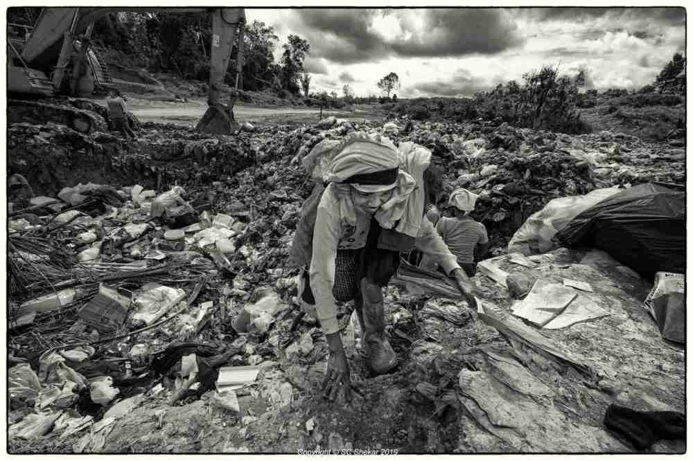An Orang Asli woman is seen scavenging through the landfill. ― Picture by SC Shekar