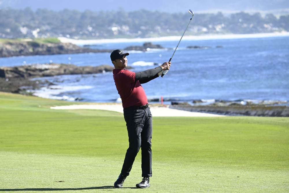 Jason Day hits his fairway shot on the 18th hole during the second round of the AT&T Pebble Beach Pro-Am golf tournament at Pebble Beach Golf Links. ― Michael Madrid-USA TODAY Sports pic via Reuters