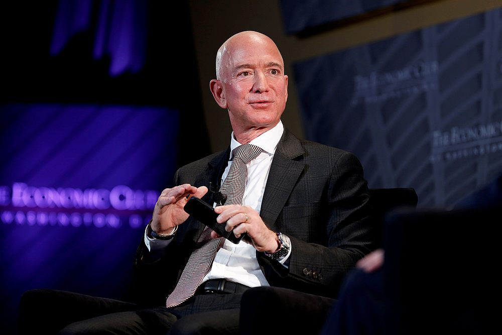 Jeff Bezos, president and CEO of Amazon and owner of 'The Washington Post', speaks at the Economic Club of Washington DC's 'Milestone Celebration Dinner' in Washington September 13, 2018. — Reuters pic