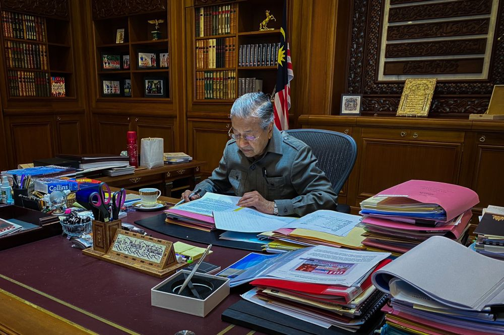 For Tun Dr Mahathir, it's just another day in the office. — Picture via Twitter