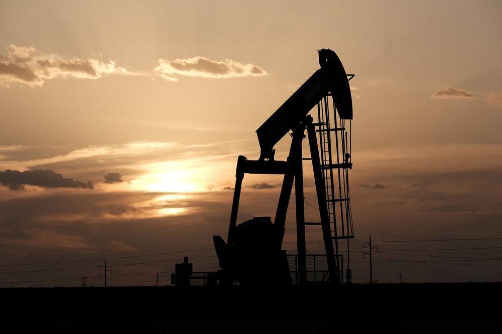 Oil pump jacks work at sunset near Midland, Texas, US, August 21, 2019. — Reuters pic