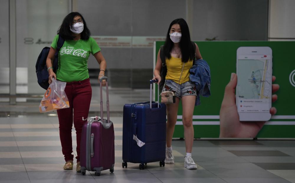 Tourists wearing masks at the Kota Kinabalu International Airport January 24, 2020, following the novel coronavirus outbreak. — Bernama pic