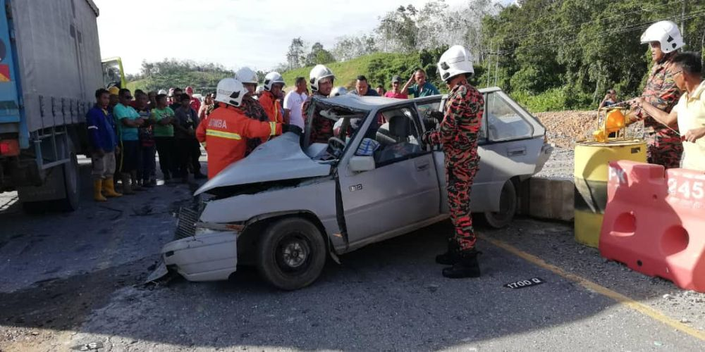 The damaged car after a head-on collision with a truck laden with medical waste in Saratok, February 6, 2020. — Picture courtesy of the Saratok Fire and Rescue Department