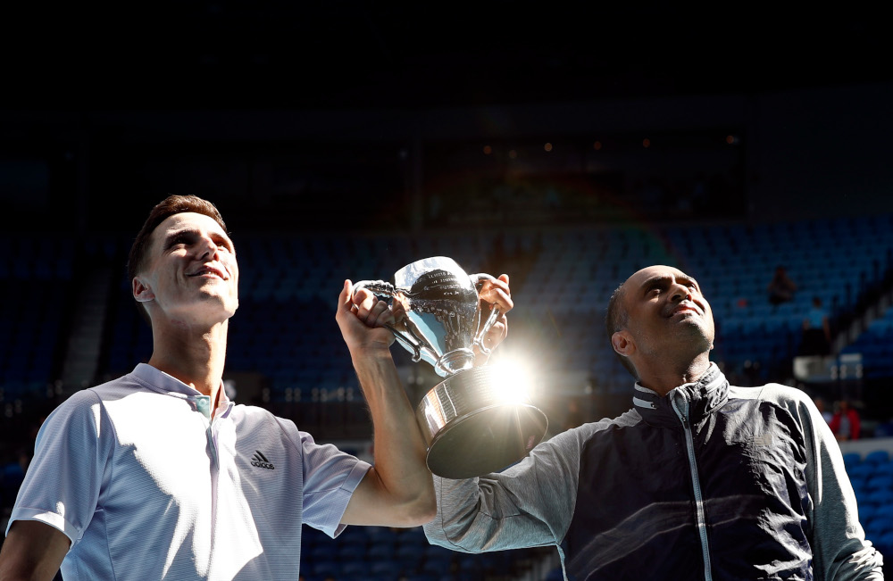 Rajeev Ram of the US and Britain's Joe Salisbury celebrate with the trophy after winning the final against Australia's Max Purcell and Luke Saville at Melbourne Park, Australia February 2, 2020. — Reuters pic