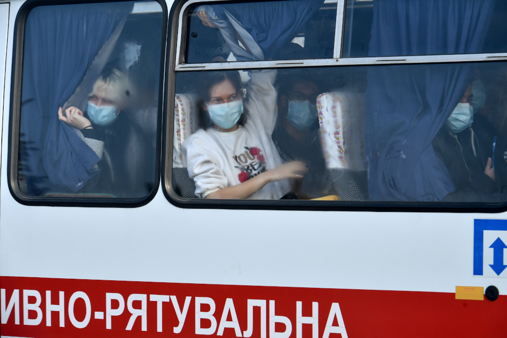 Evacuees from coronavirus-hit China look out from a bus as they leave an airport in Kharkiv, Ukraine February 20, 2020. The Malaysian embassy in Ukraine said seven Malaysians are unable to leave Ukraine for Malaysia via Istanbul or any other destinations due to flight cancellations. — AFP pic