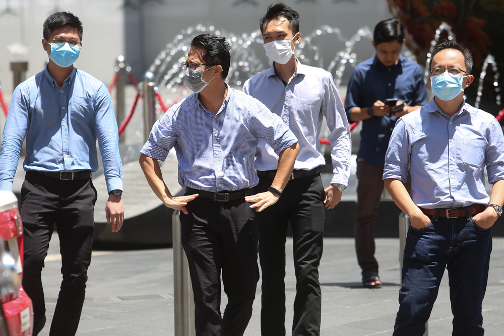 Office workers are seen wearing masks along Jalan Bukit Bintang, Kuala Lumpur March 16 2020. — Picture by Choo Choy May